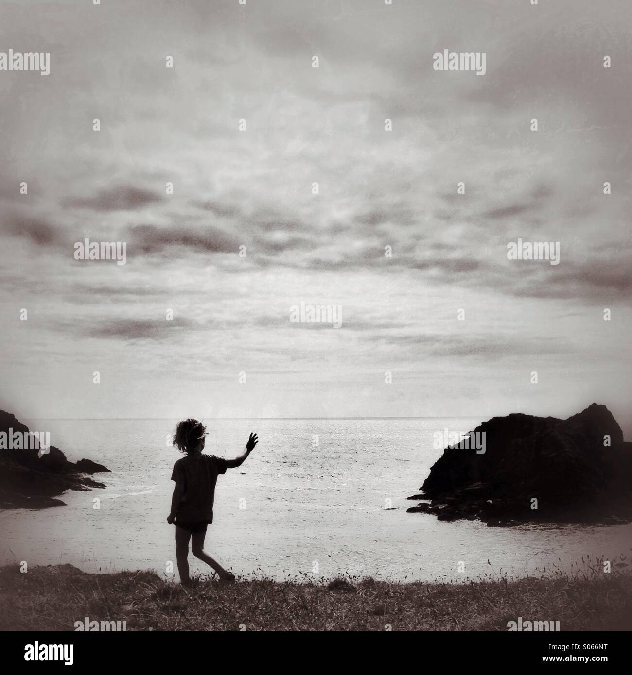 Child on a cliff at Soar mill cove - Stock Image