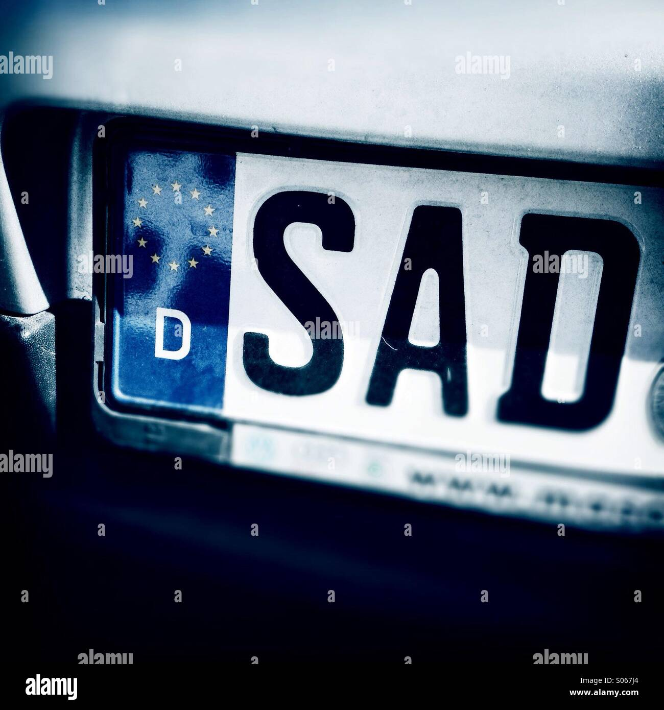 Sad letters. License plate of Schwandorf, Bayern, Germany, Europe - Stock Image