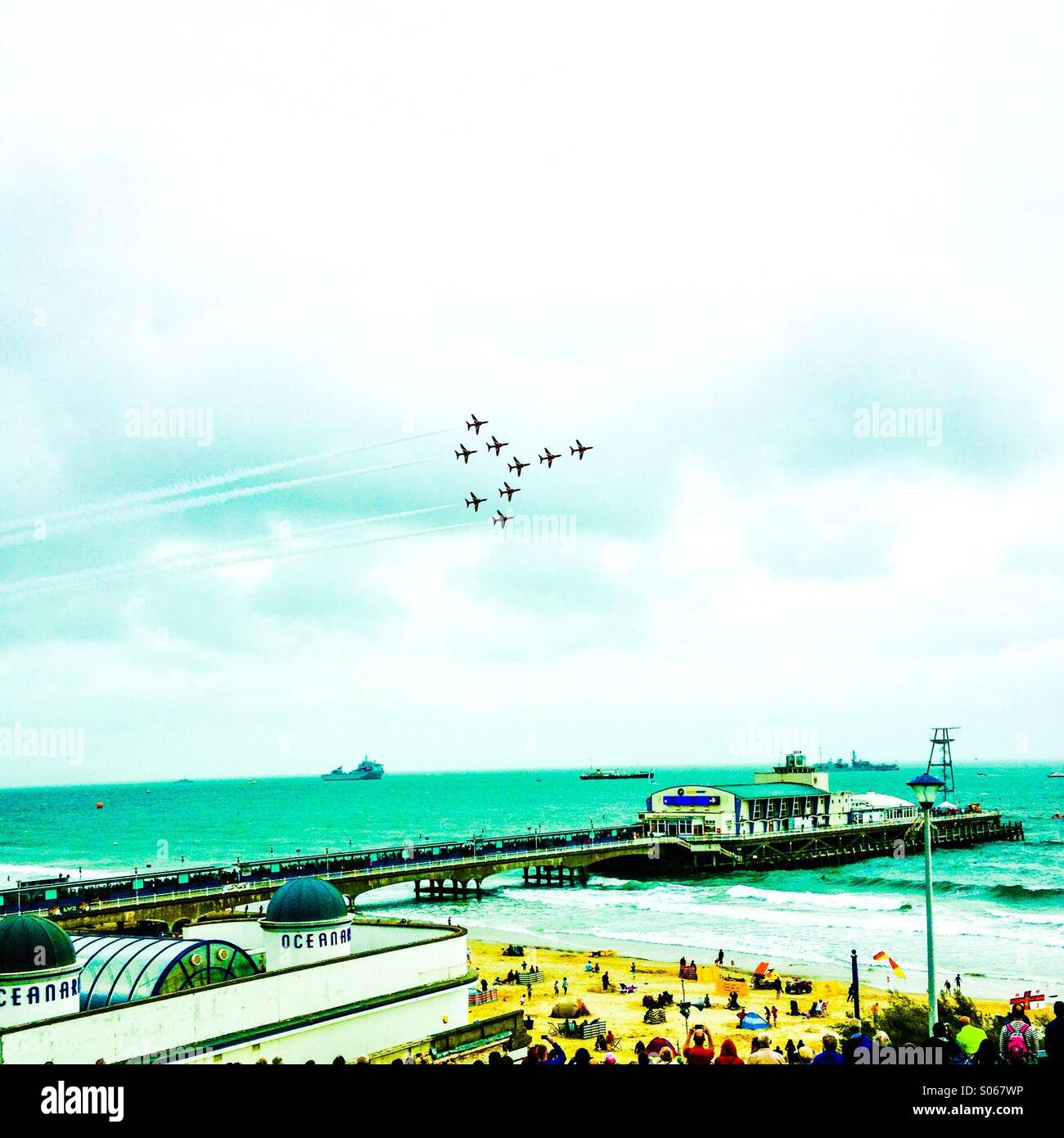 Red arrows on formation over pier air festival 2014 - Stock Image
