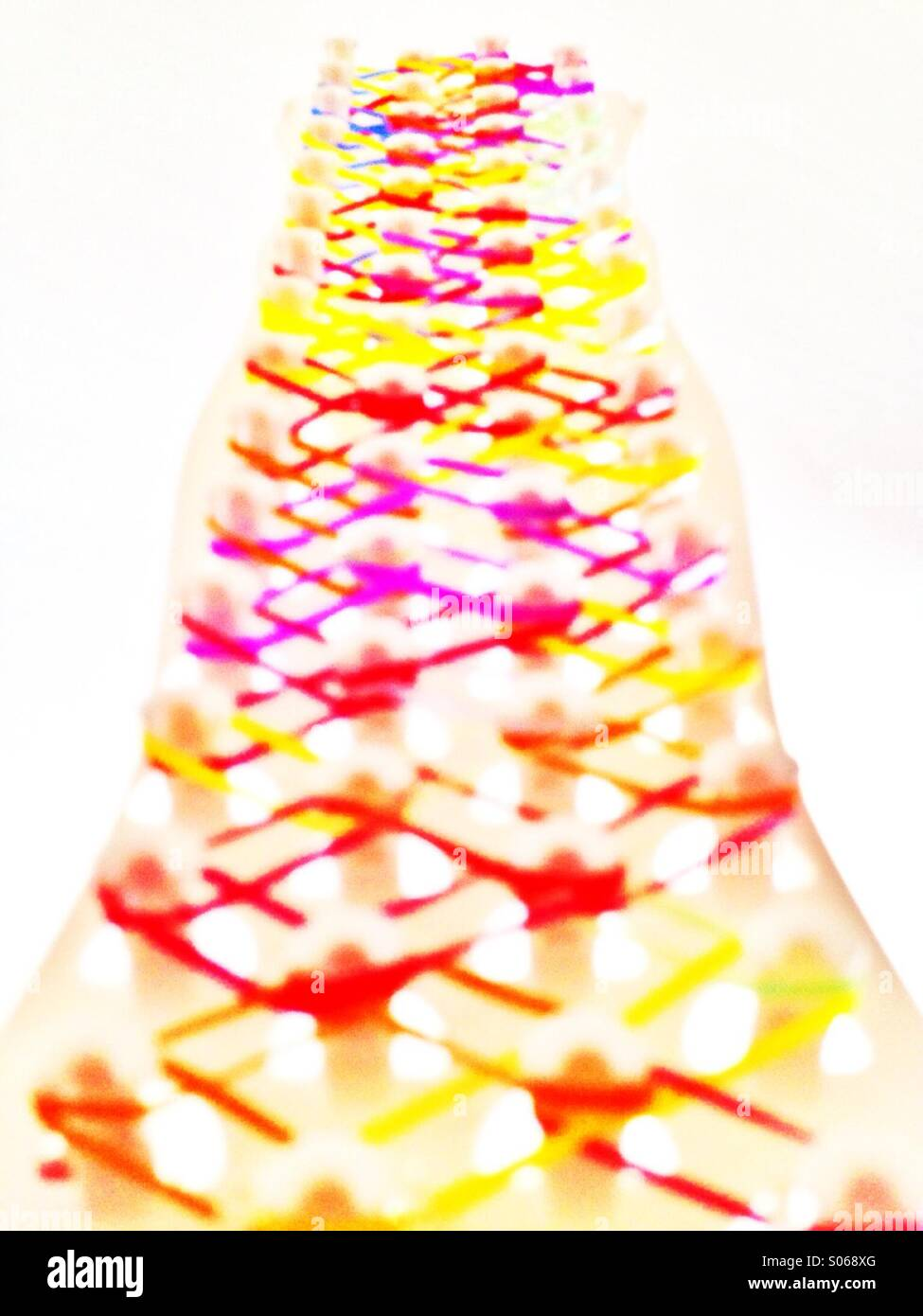Loom bands on a loom - Stock Image
