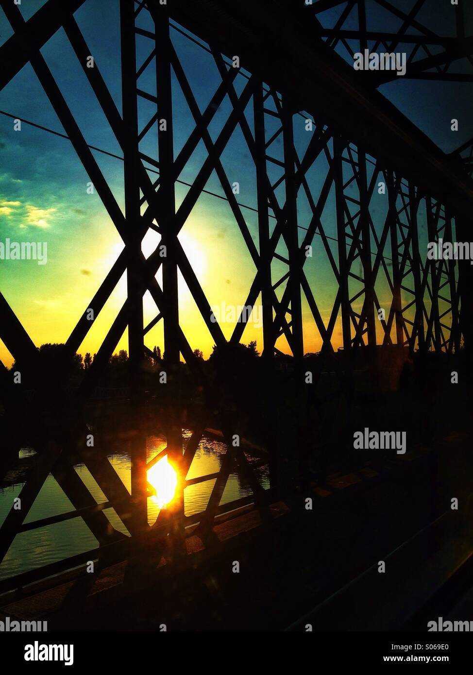 Train bridge sunset - Stock Image