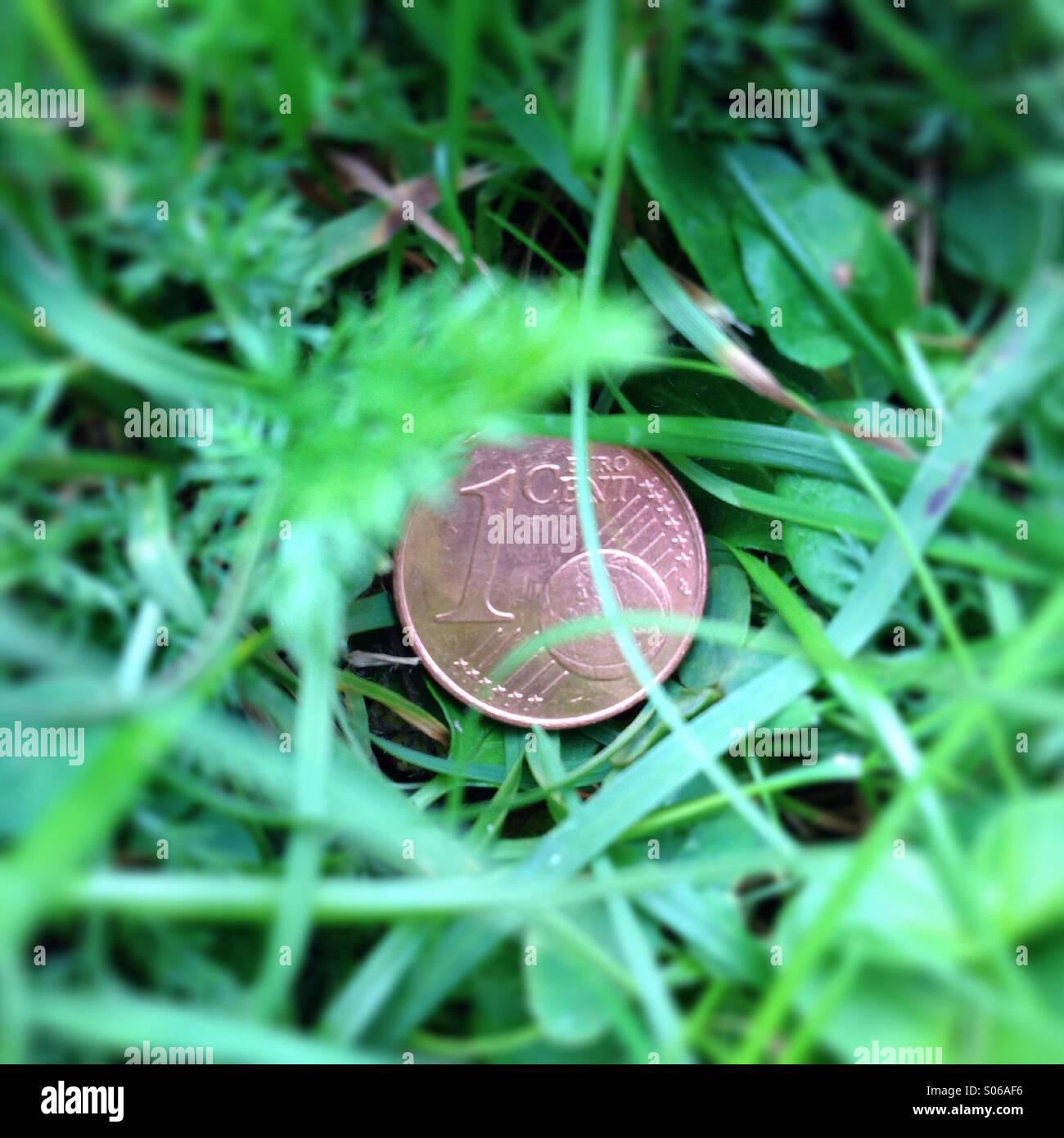 Cent im Gras - Stock Image