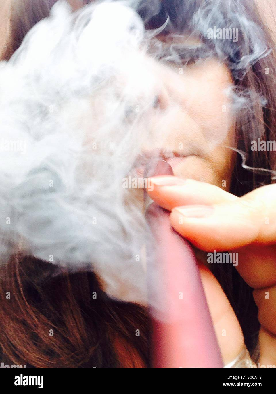 Me smoking an electronic cigarette - Stock Image