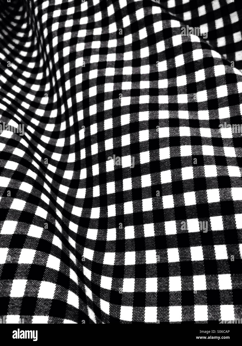 Black and white grid, warped - Stock Image