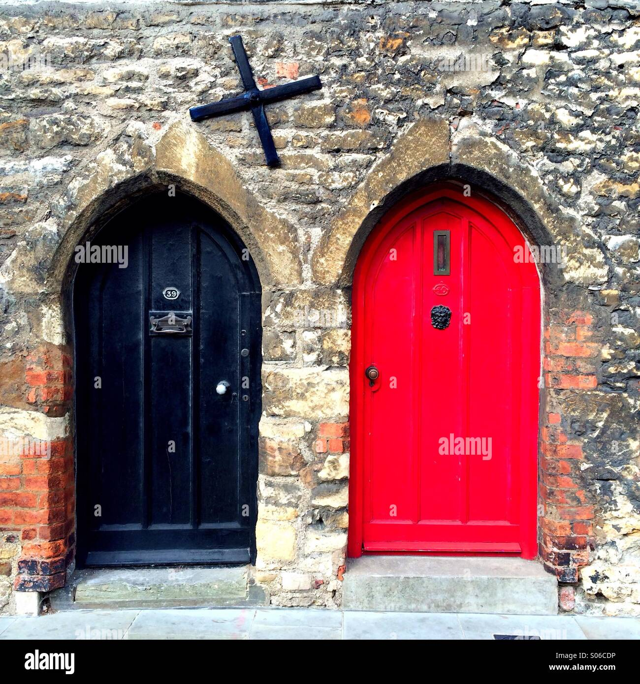 Medieval arched black and red doors, Bailgate, Lincoln UK - Stock Image