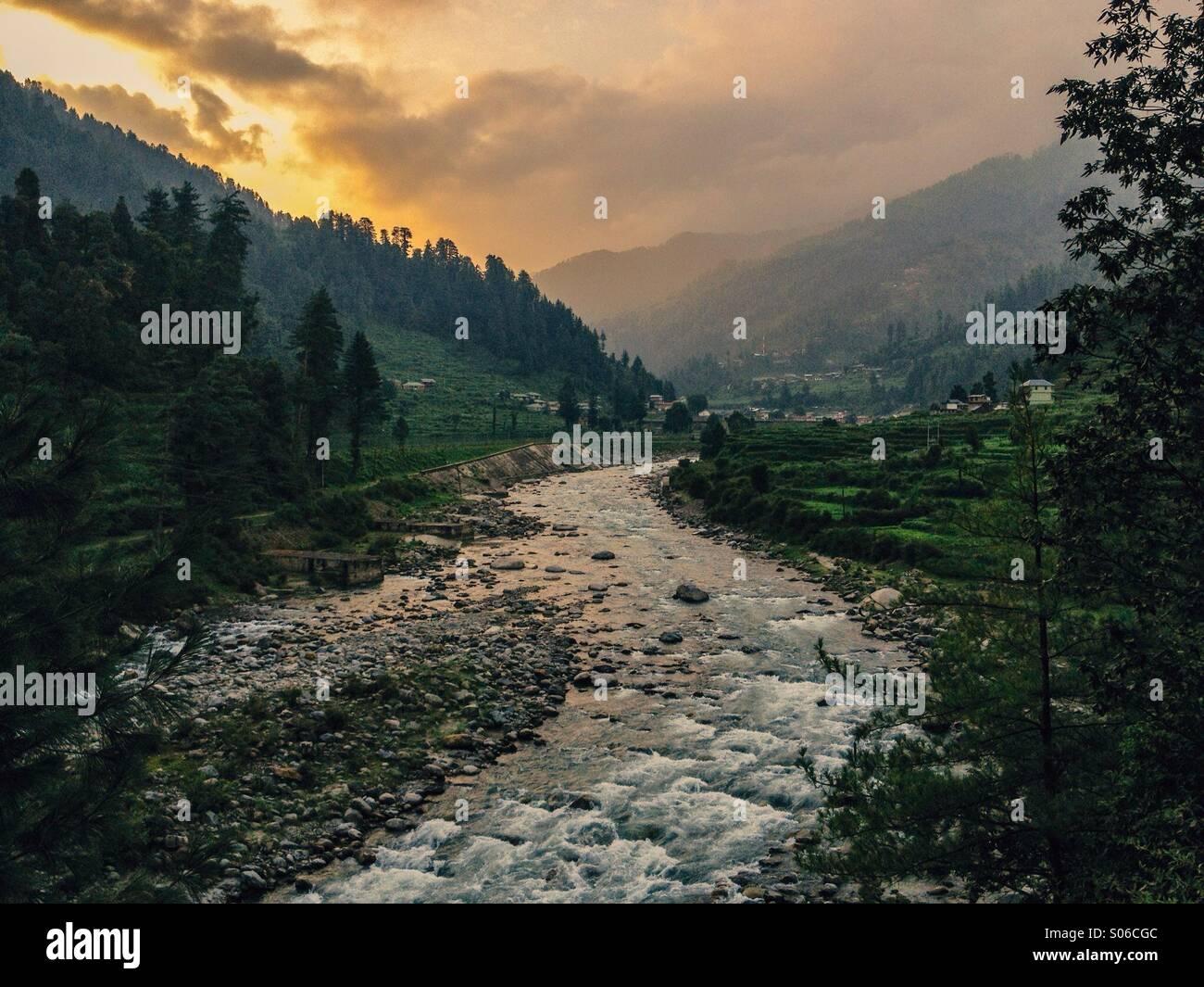 River Uhl flowing at a sunset through Barot, Himachal Pradesh, India - Stock Image