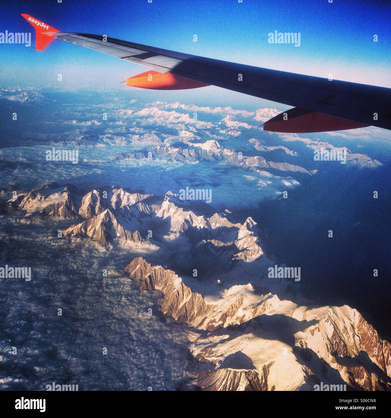 View of the Alps with Montblanc from an aeroplane window - Stock Image