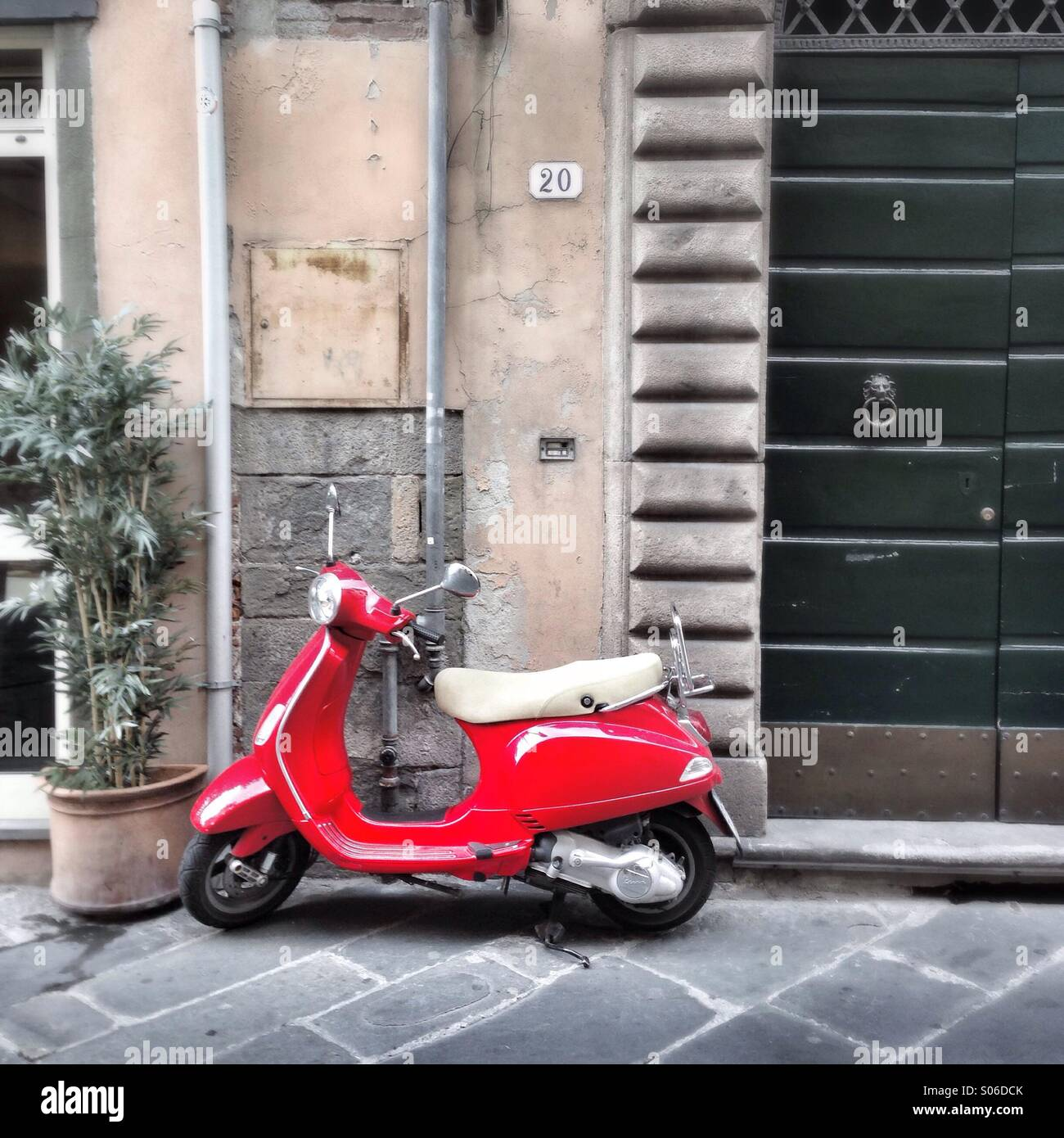 Red Vespa scooter in Lucca, Tuscany, Italy Stock Photo