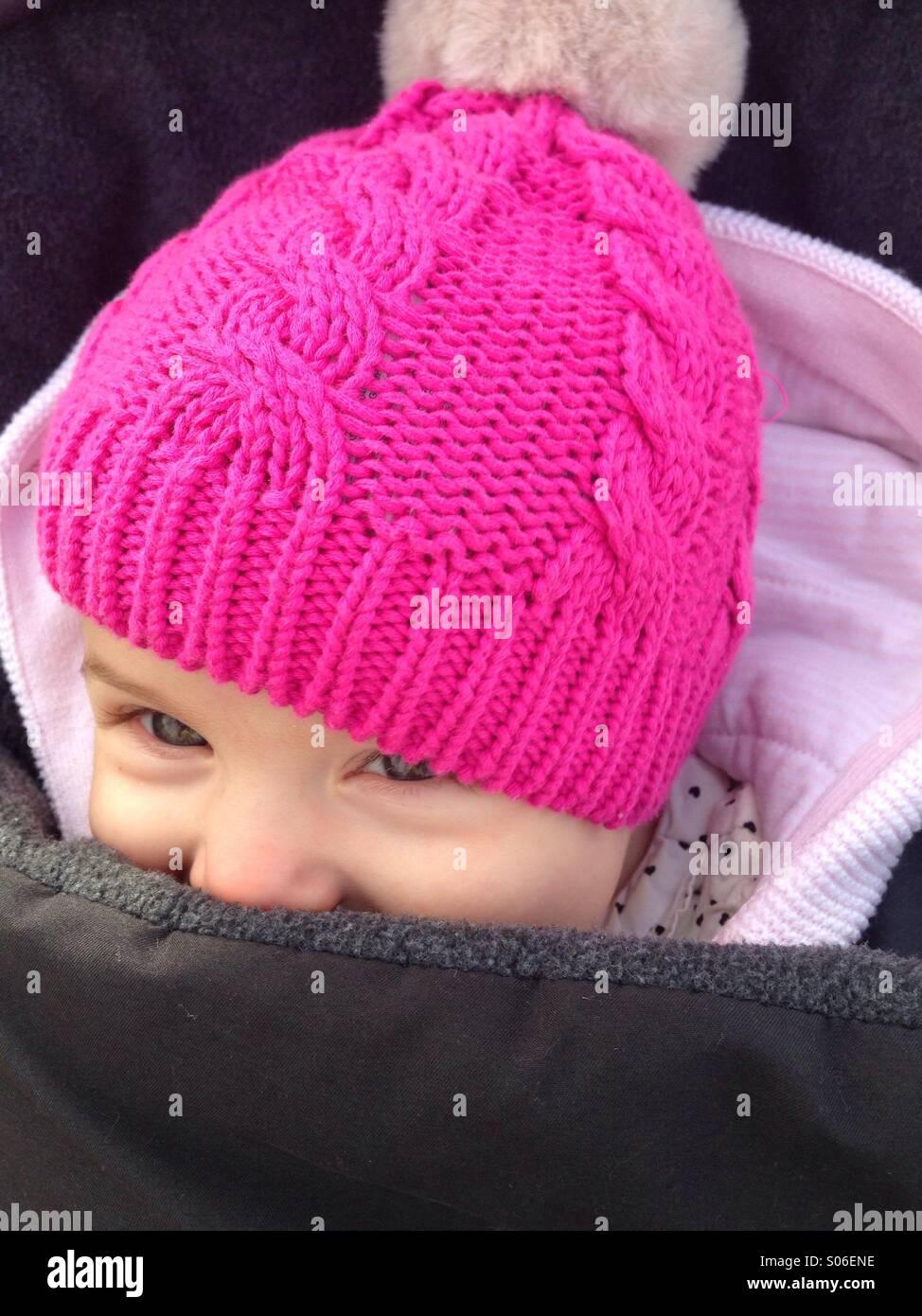 Happy baby in pram - Stock Image