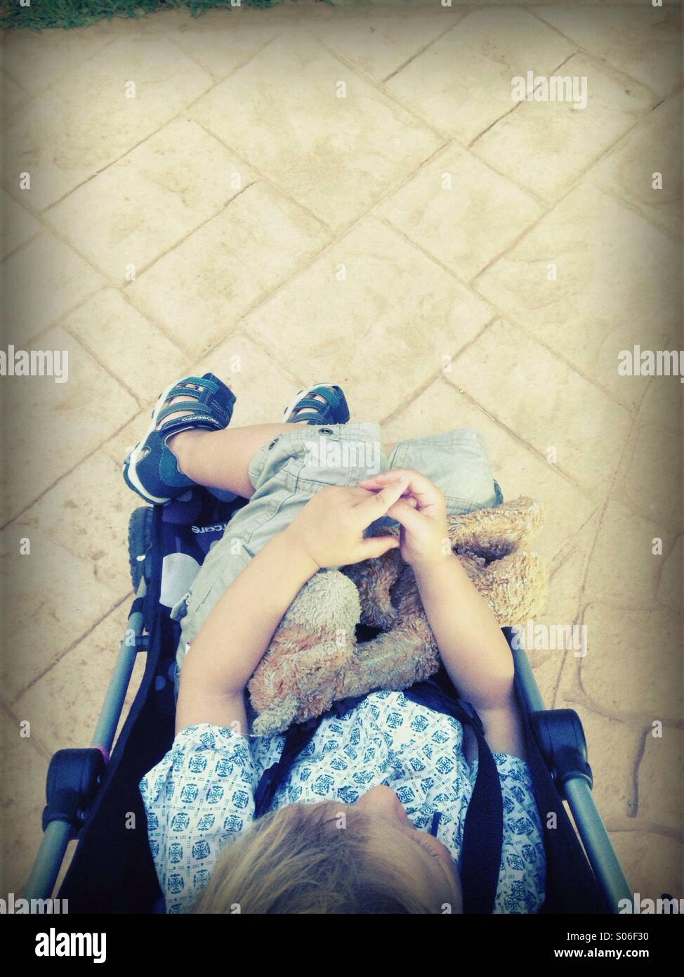 A parents view of child in a pushchair - Stock Image