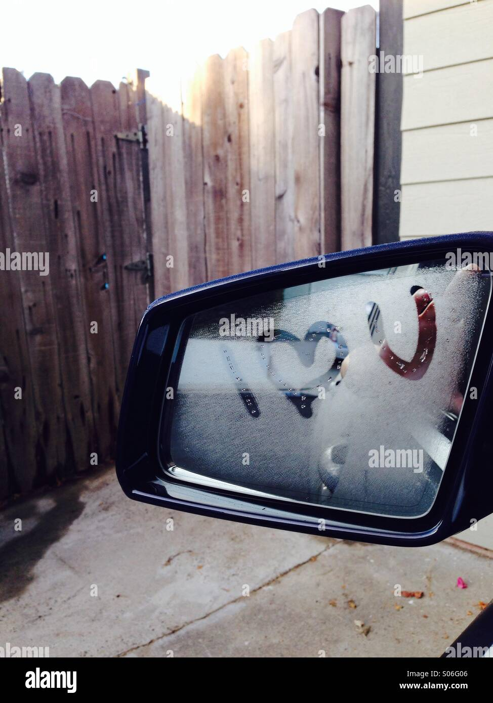 I love you written on a rear view mirror - Stock Image