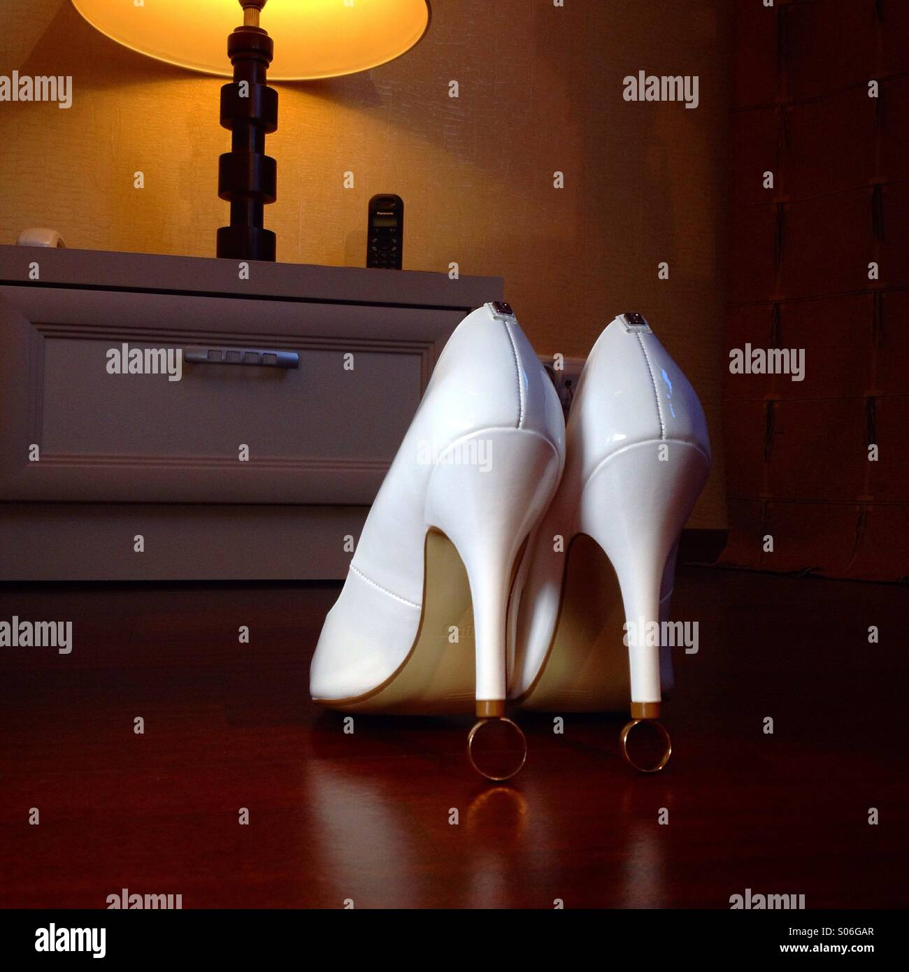 Bride shoes on weddin rings - Stock Image