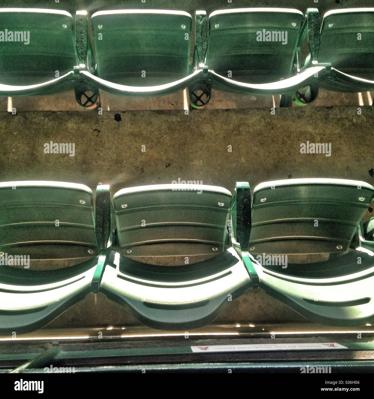 Seats at a baseball stadium - Stock Image