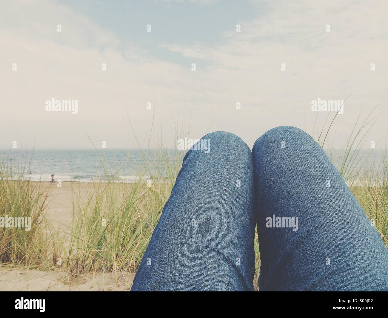 Relaxing in the sand dunes - Stock Image