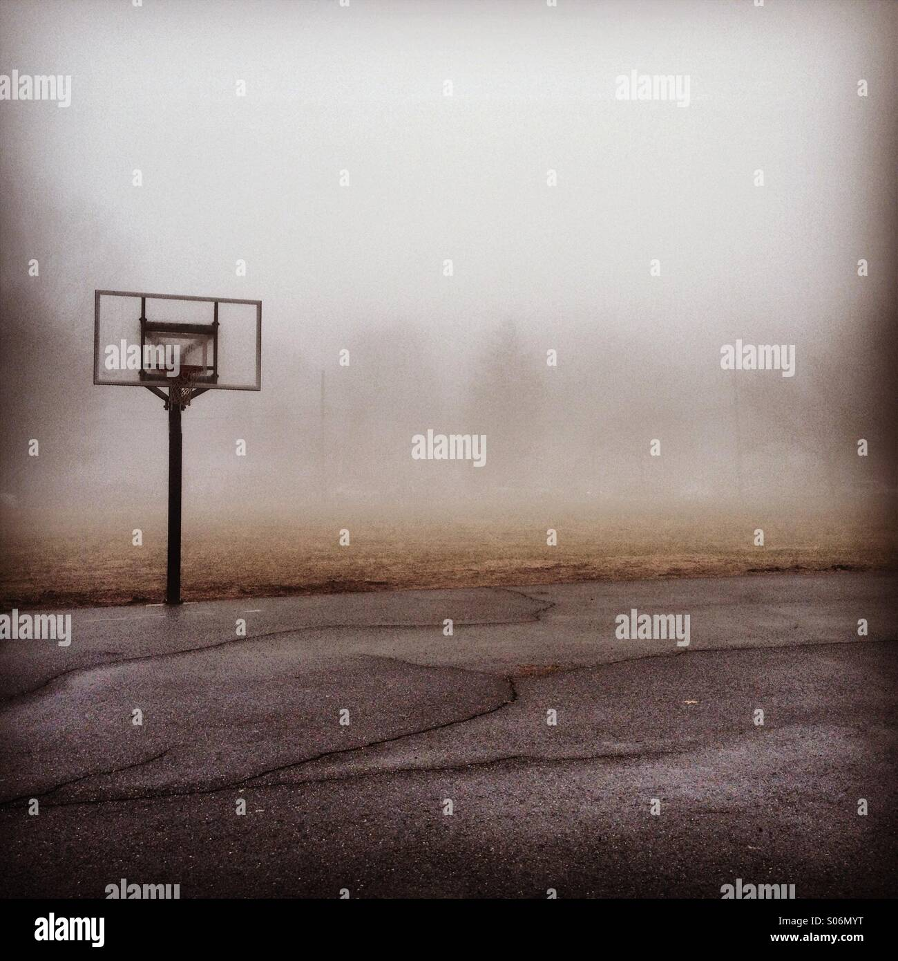 Playground in the Fog - Stock Image