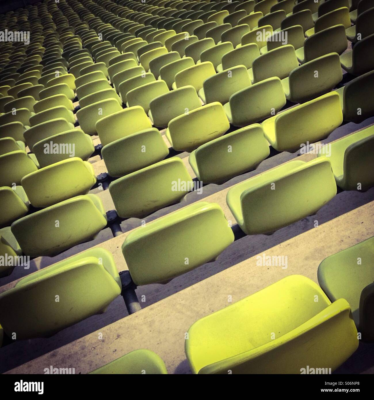 Row of empty green seats at stadium sport - Stock Image
