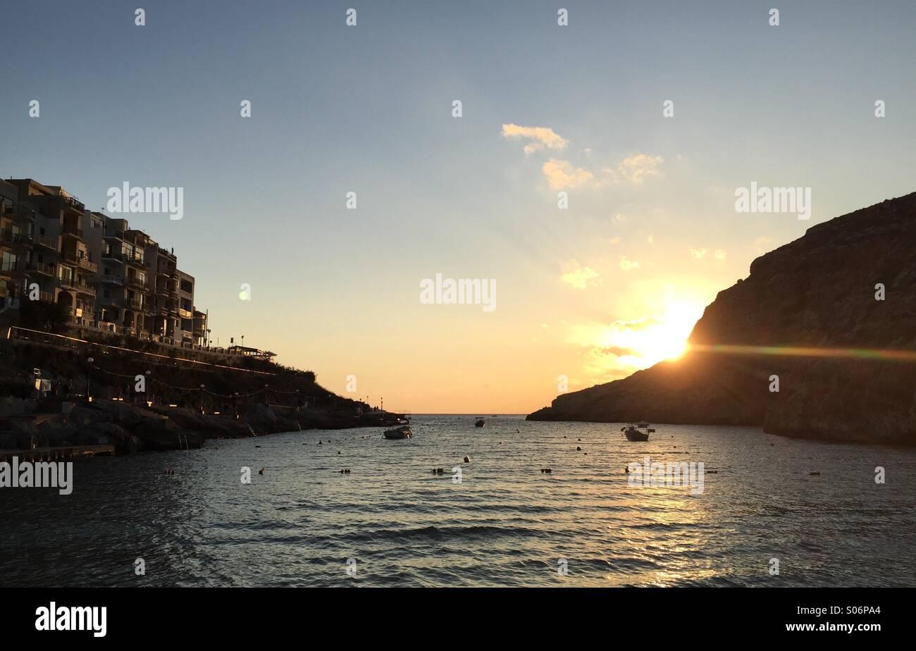 Sunset at Xlendi Bay in Gozo - Stock Image