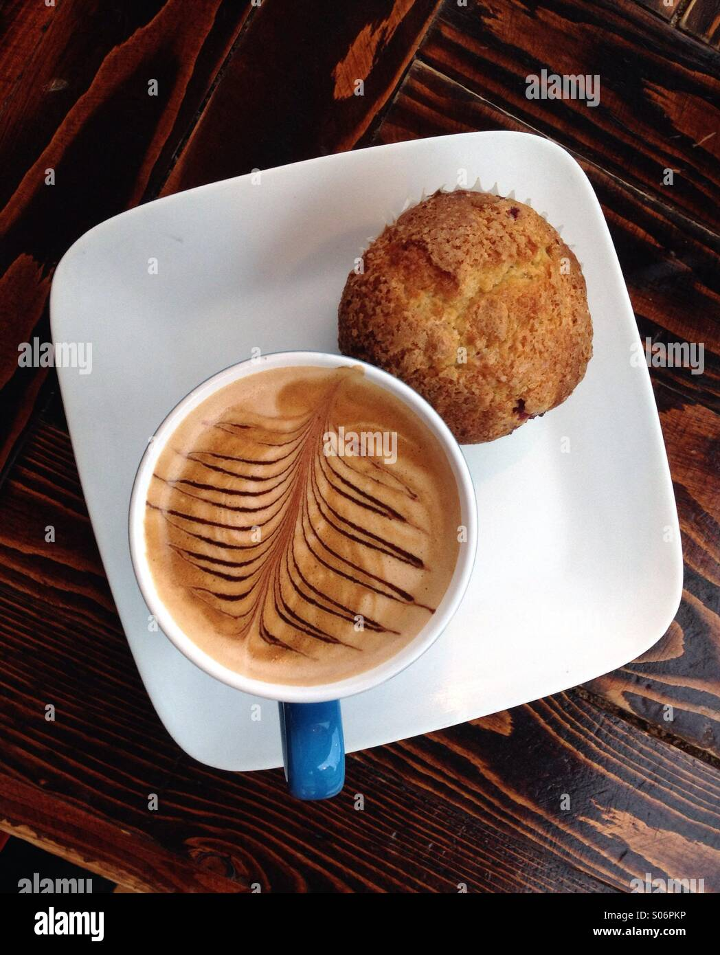 Artistic mocha with cranberry muffin - Stock Image