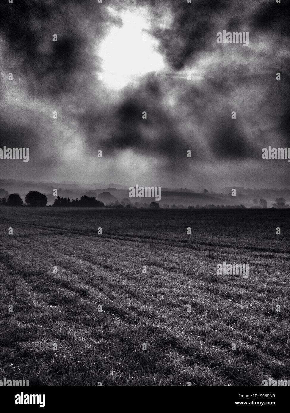 Overcast countryside with mist in valley - Stock Image