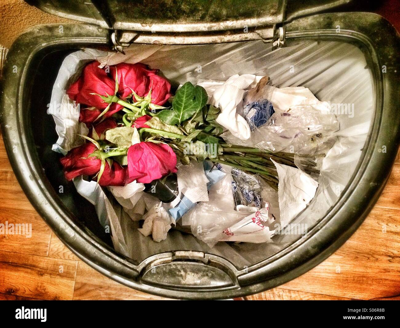 A bouquet of flowers in the trash stock photo 309936603 alamy a bouquet of flowers in the trash izmirmasajfo