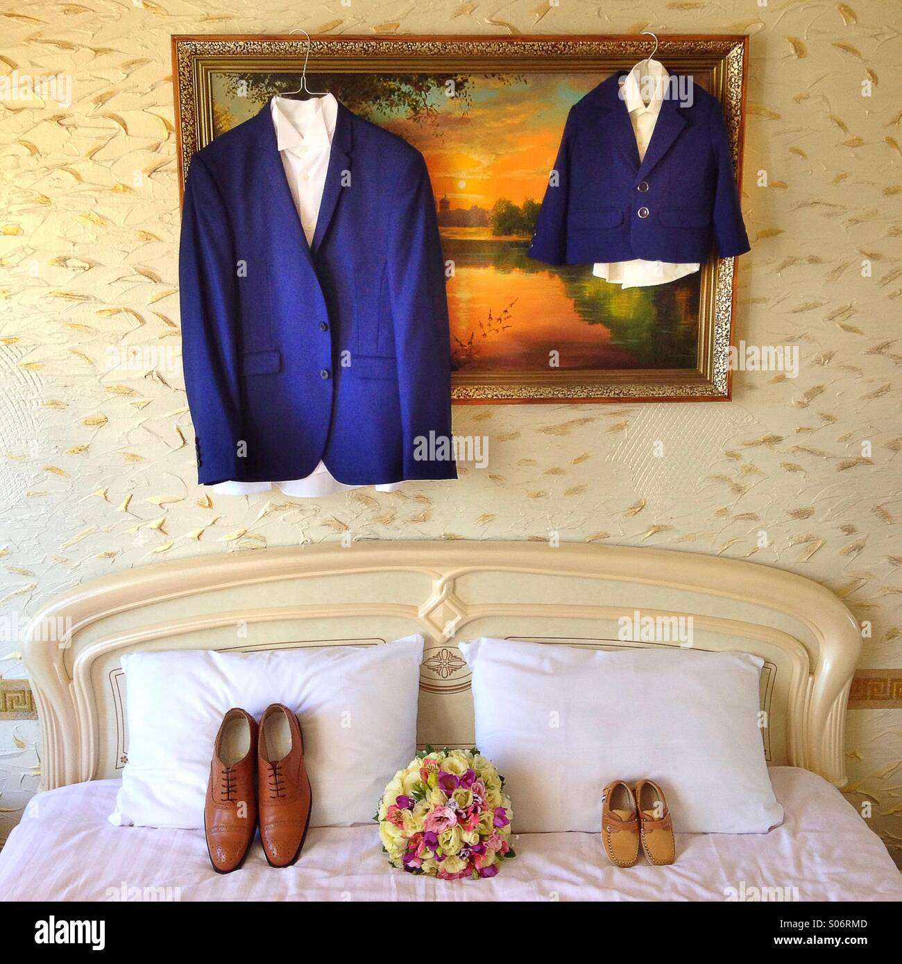 Wedding accesories, groom suit and his son suit - Stock Image