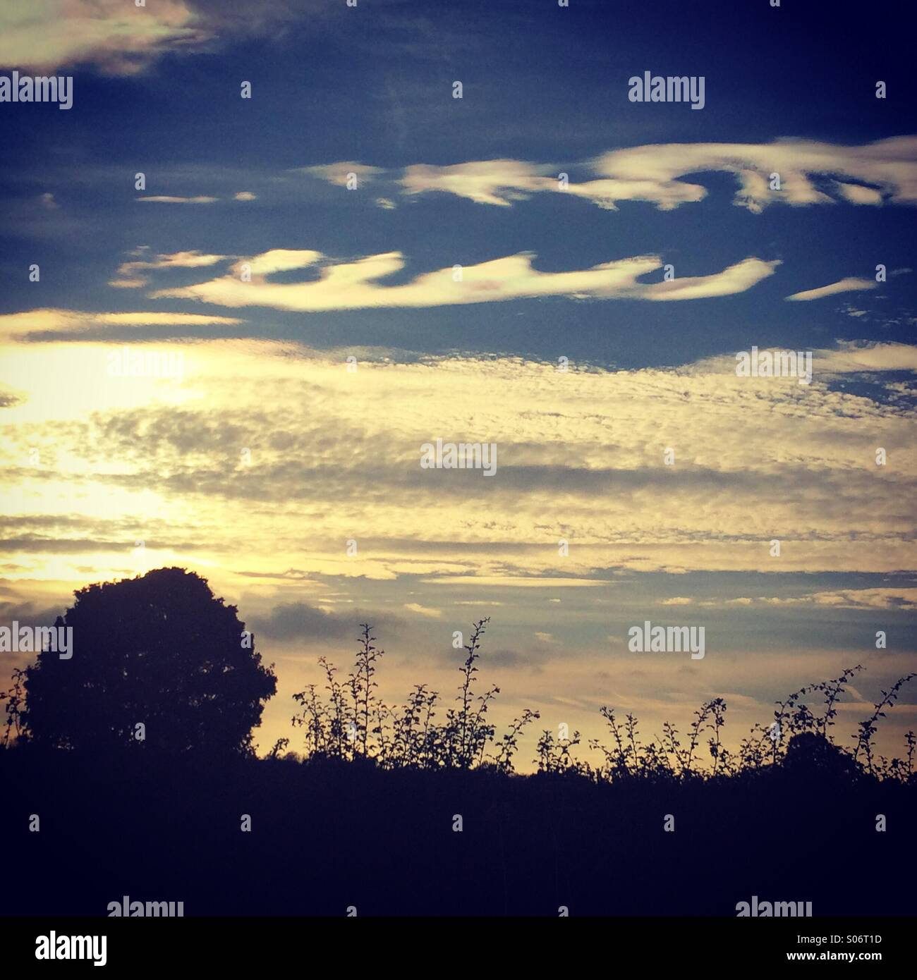 Wave pattern in clouds at dusk - Stock Image