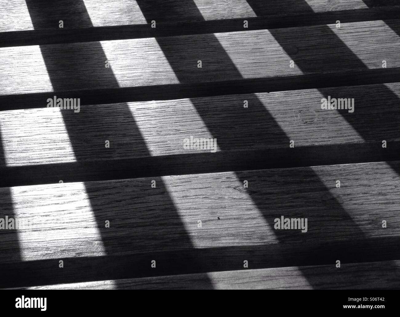 Sun drenched wooden bench - Stock Image