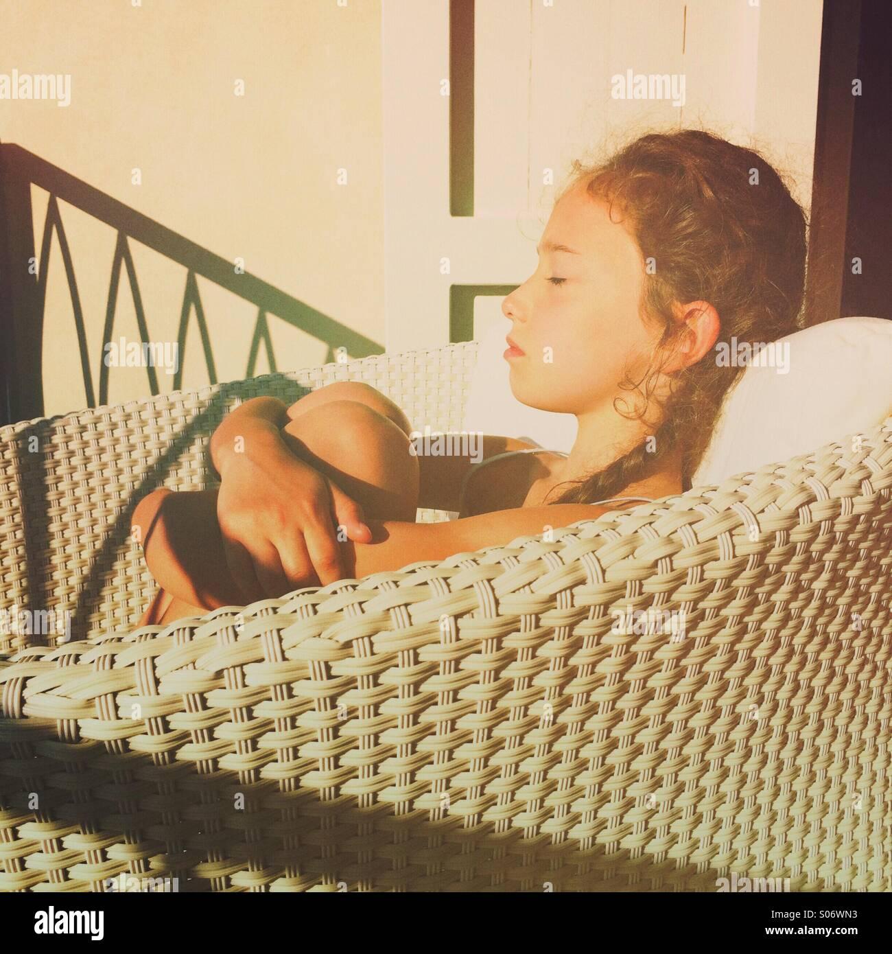 Girl enjoying the morning sun on holiday - Stock Image