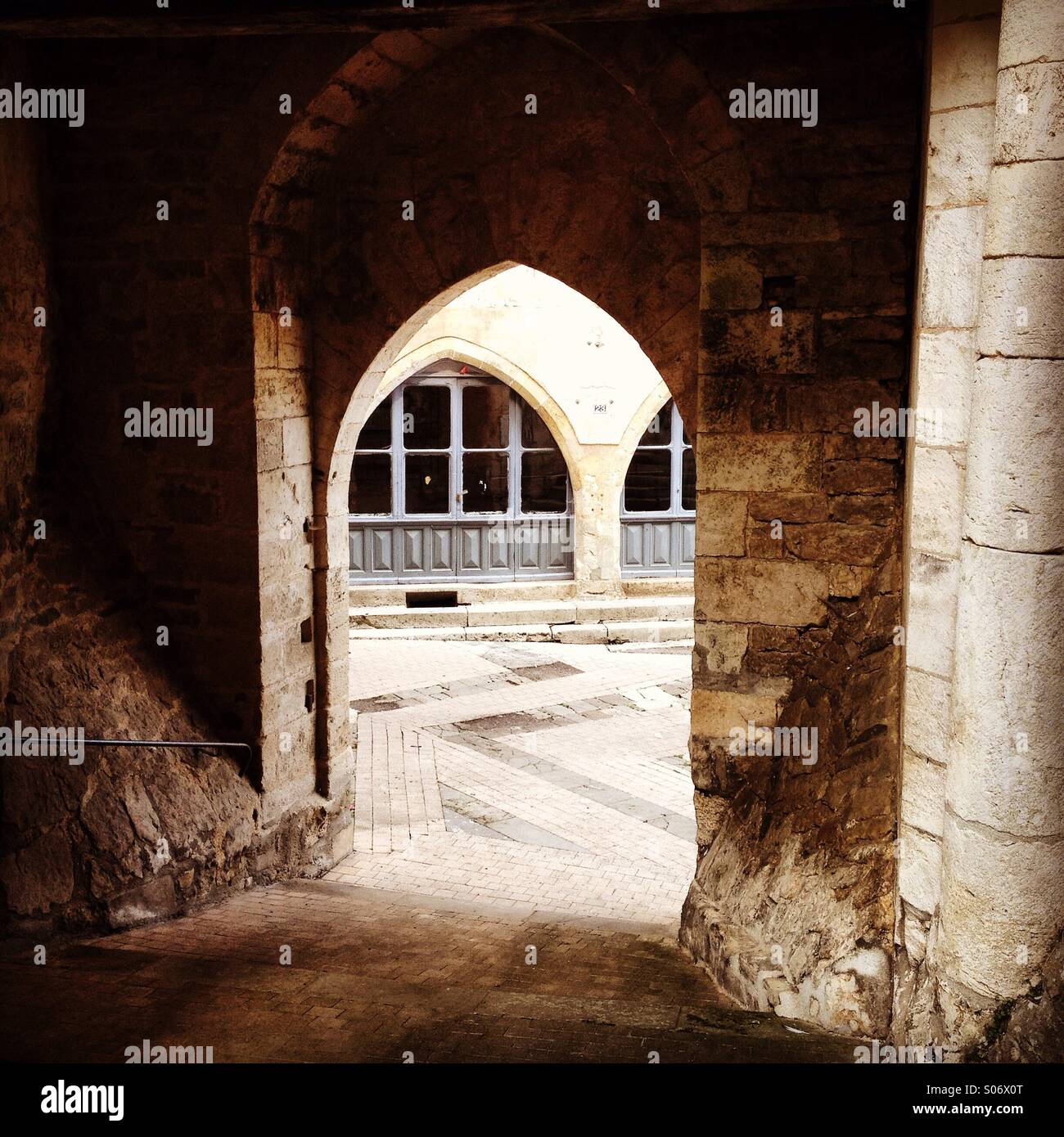 Arched doors in Caylus, France - Stock Image