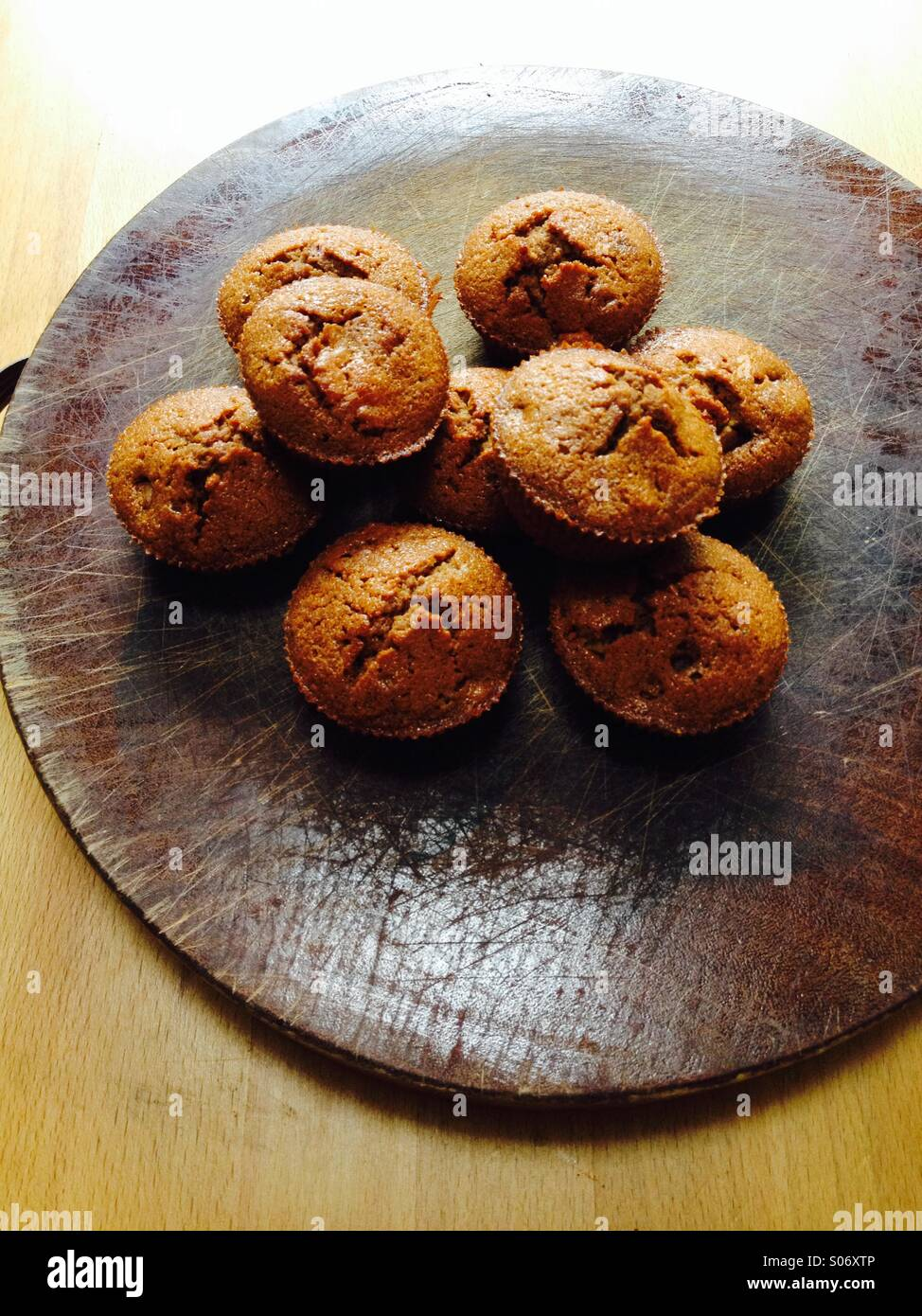 Home made coffee flavoured cup cakes on traditional wood background - Stock Image