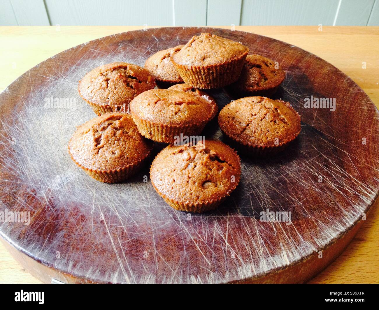 Traditional home baked cakes on a wooden background - Stock Image