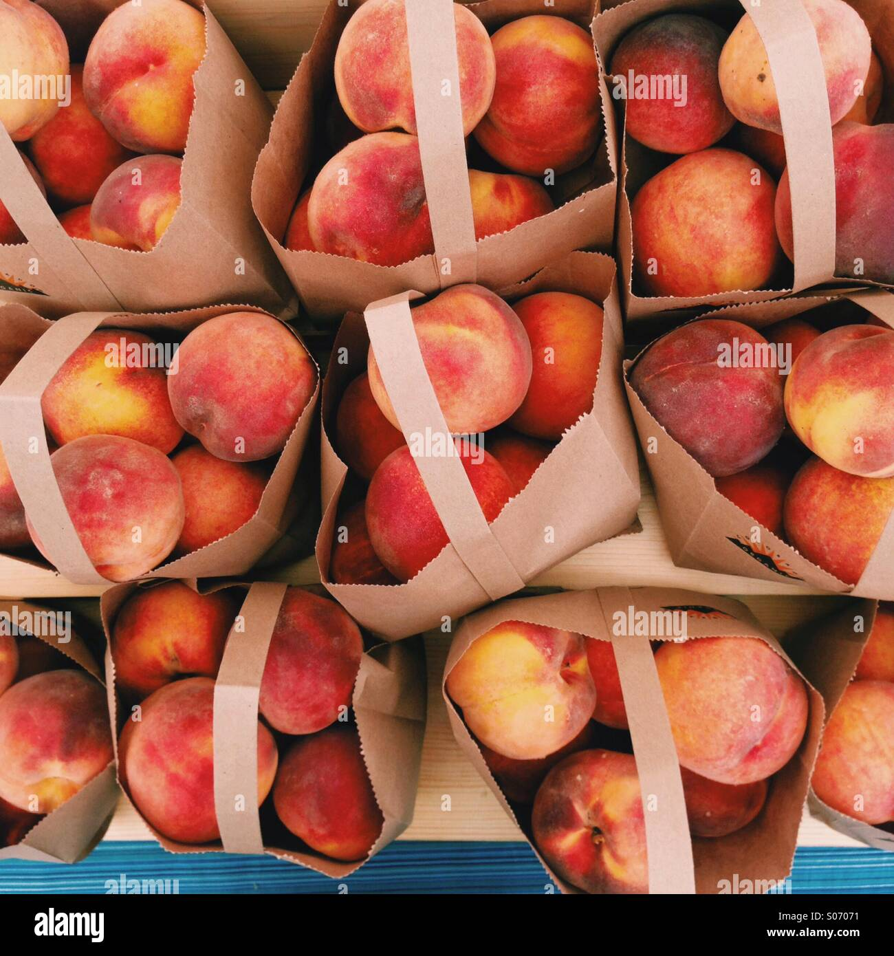 Farmers Market Peaches - Stock Image