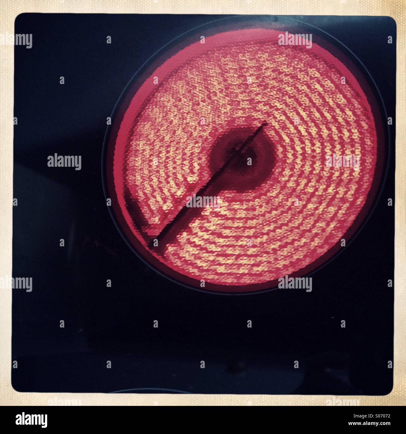 Red hot electric hob ring - Stock Image