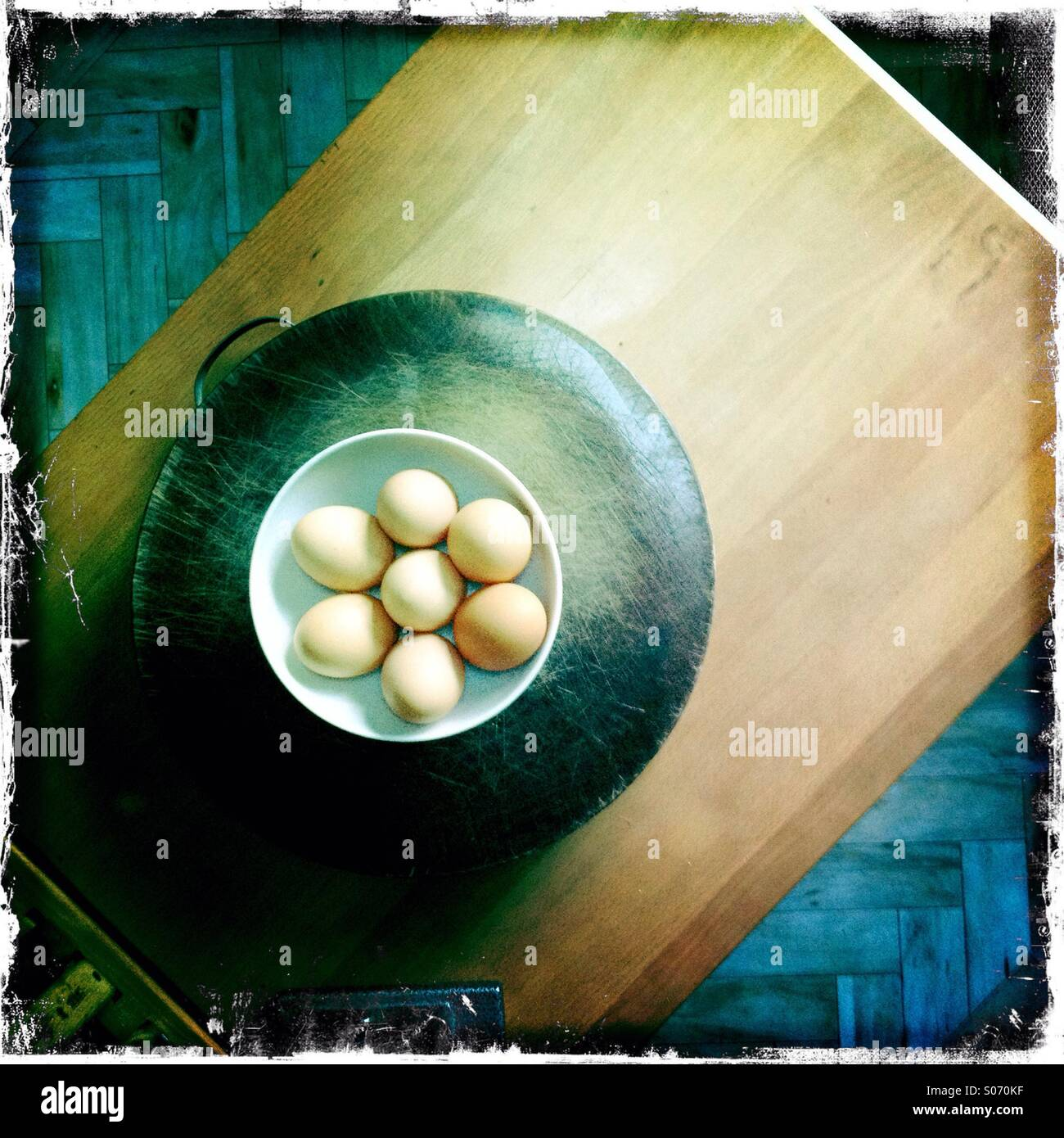Wooden kitchen work surfaces with eggs Stock Photo