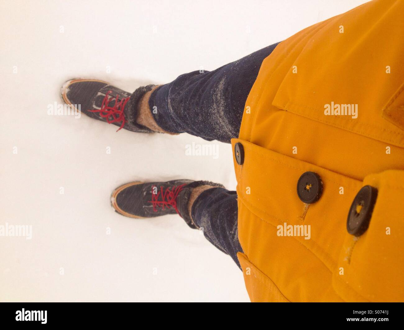 A man in winter clothes during a snowstorm in Eastern Canada Stock Photo