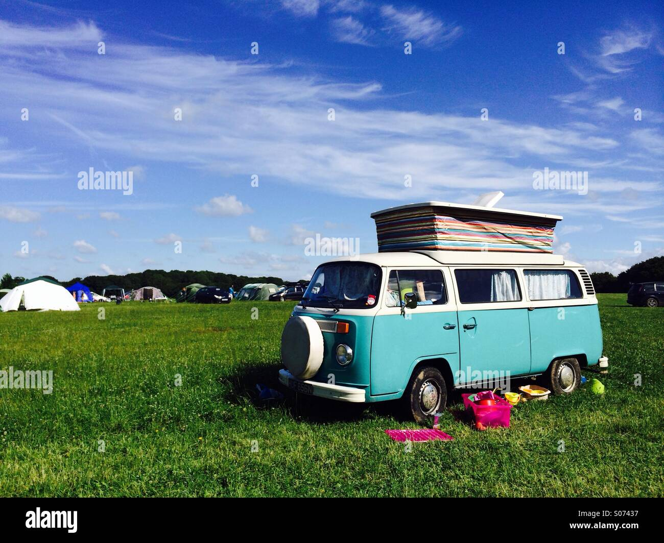 VW campervan in a camping field - Stock Image