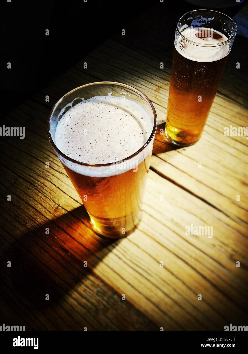 Pint and a half of beer - Stock Image