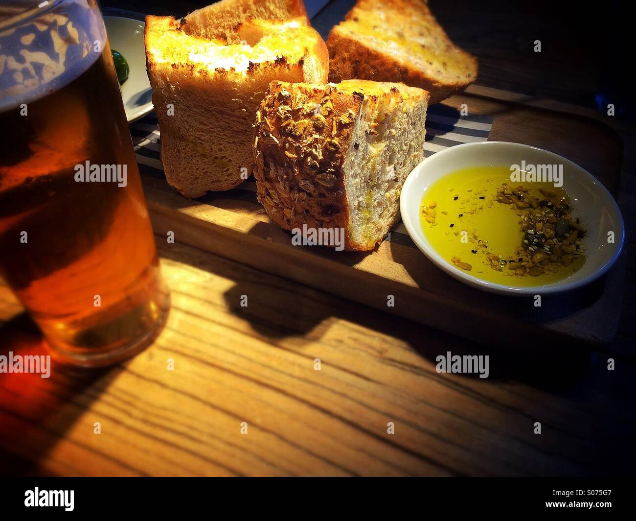Bread and beer - Stock Image