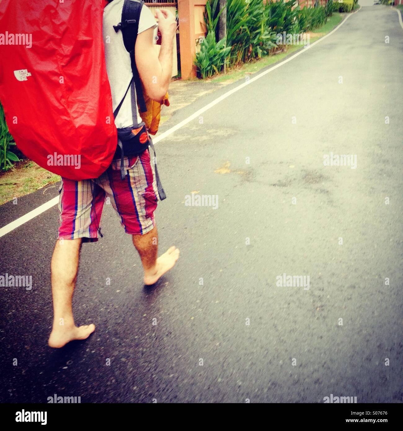 barefoot traveler - Stock Image