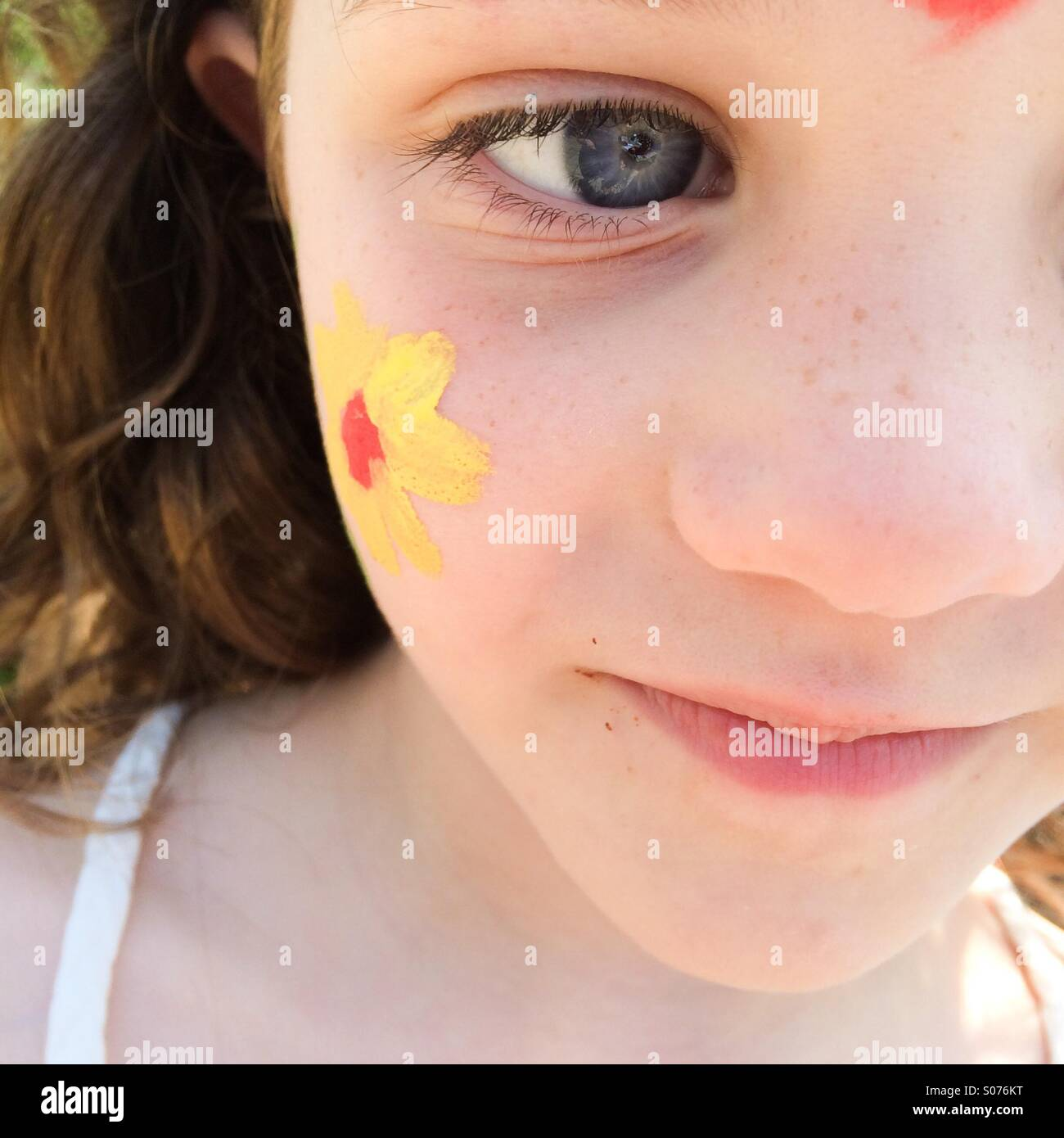 Close up of five year old girls face with face painting - Stock Image