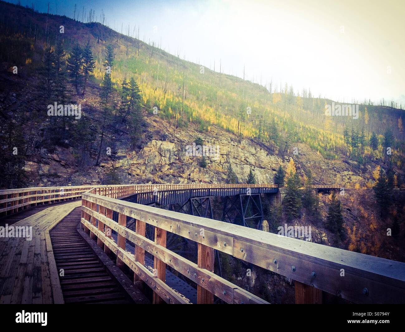 Myra Canyon trellises in the Okanagan Valley on a late fall day. Once used for railways, now it's a popular - Stock Image