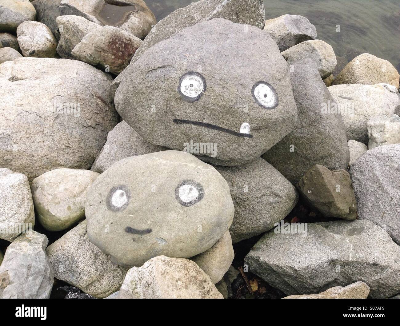 Stoned faces, rocks with painted faces - Stock Image