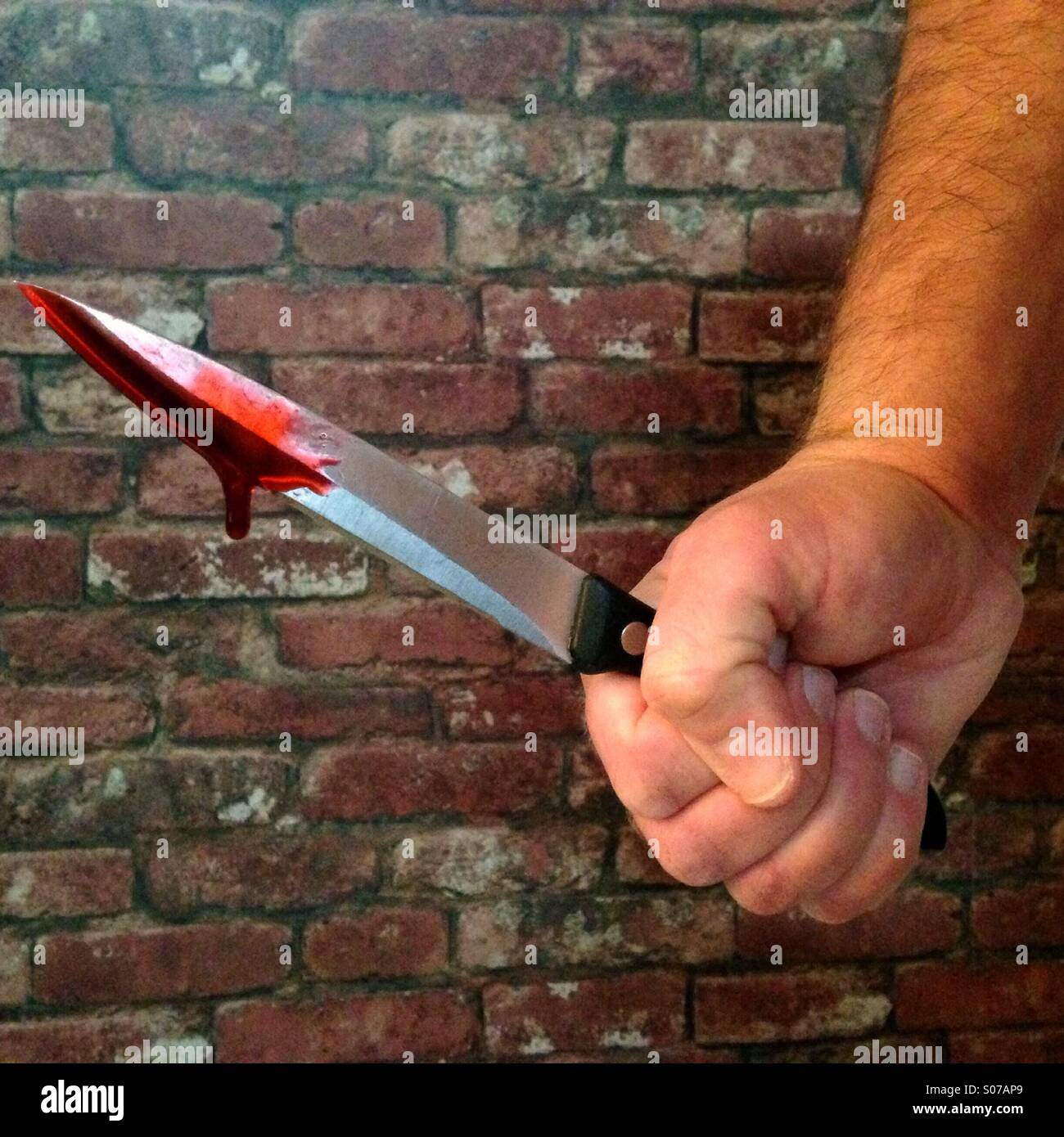 Bloodied knife - Stock Image
