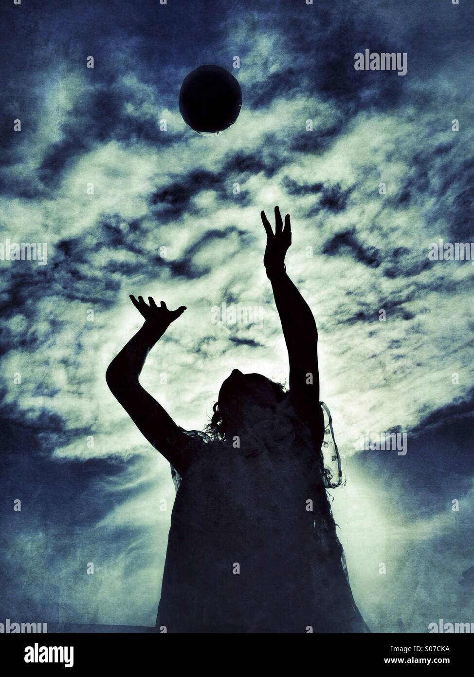 Young girl catching football - Stock Image