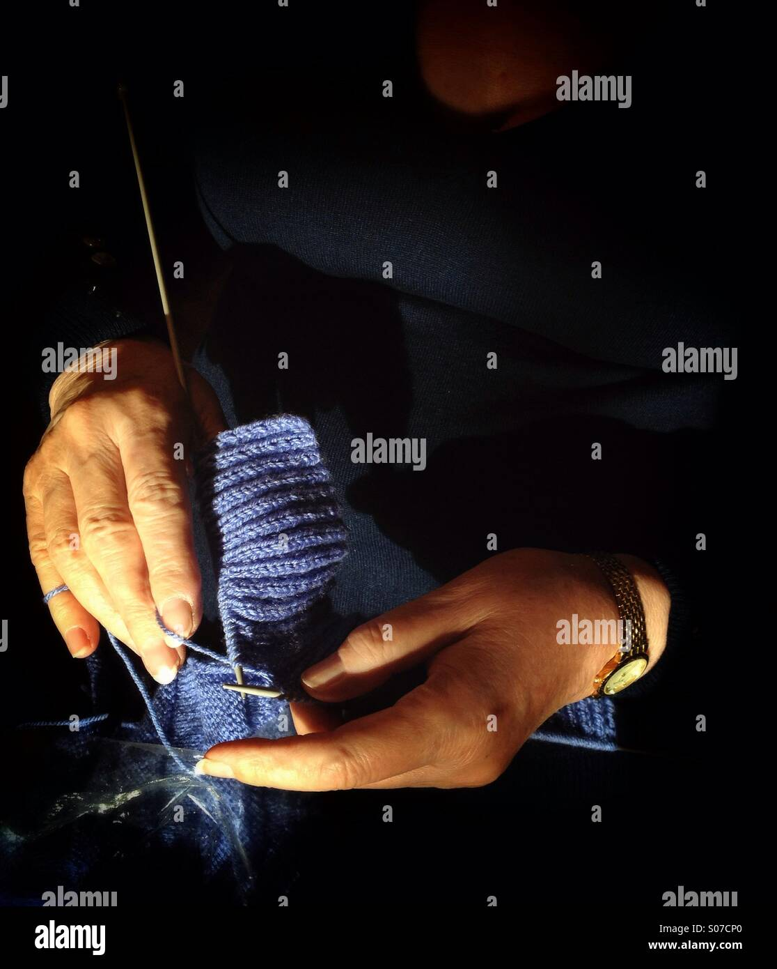 Womans hands knitting - Stock Image