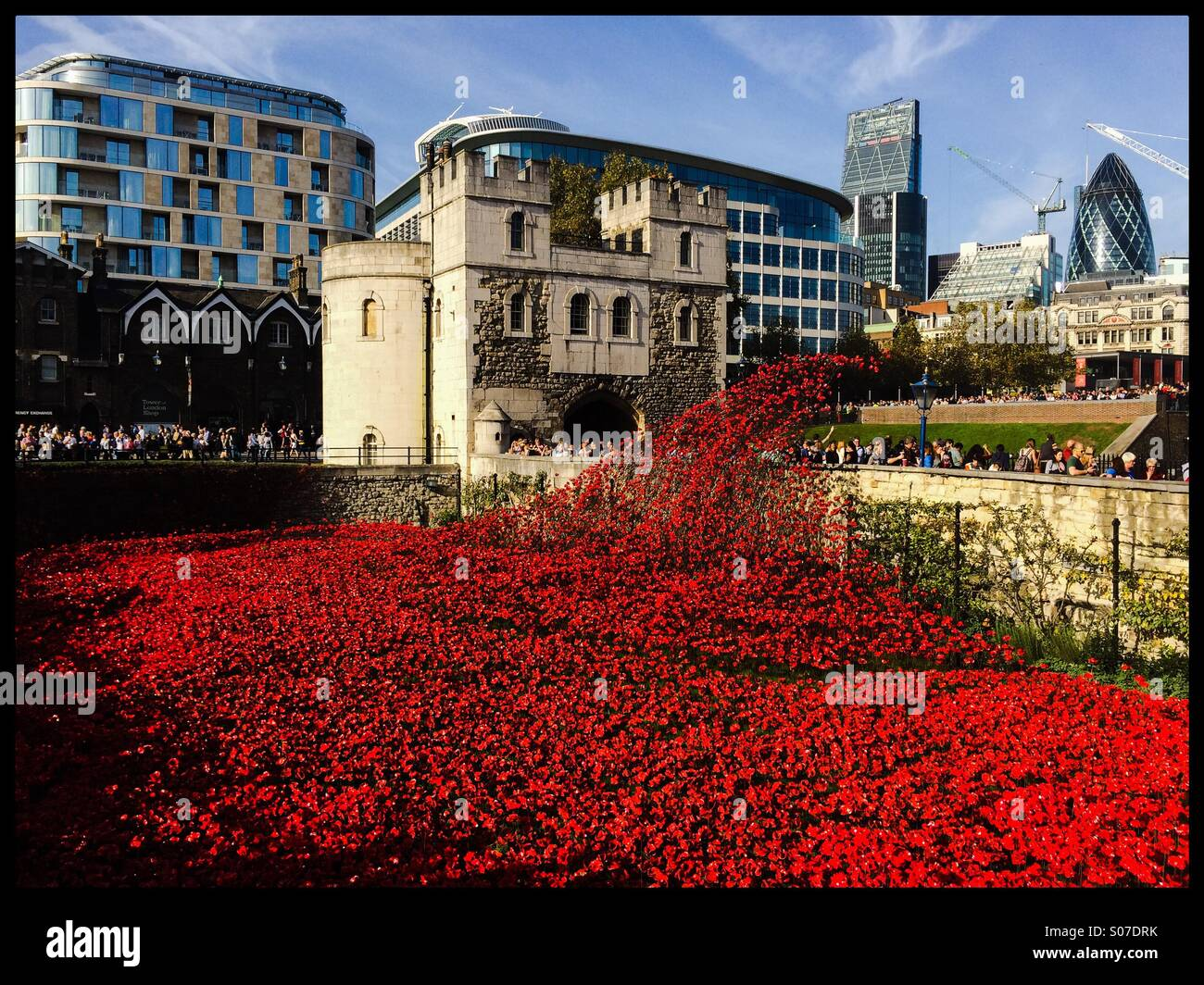 A general view of the Blood Swept Lands And Seas Of Red ceramic poppy installation at the Tower Of London in remembrance - Stock Image