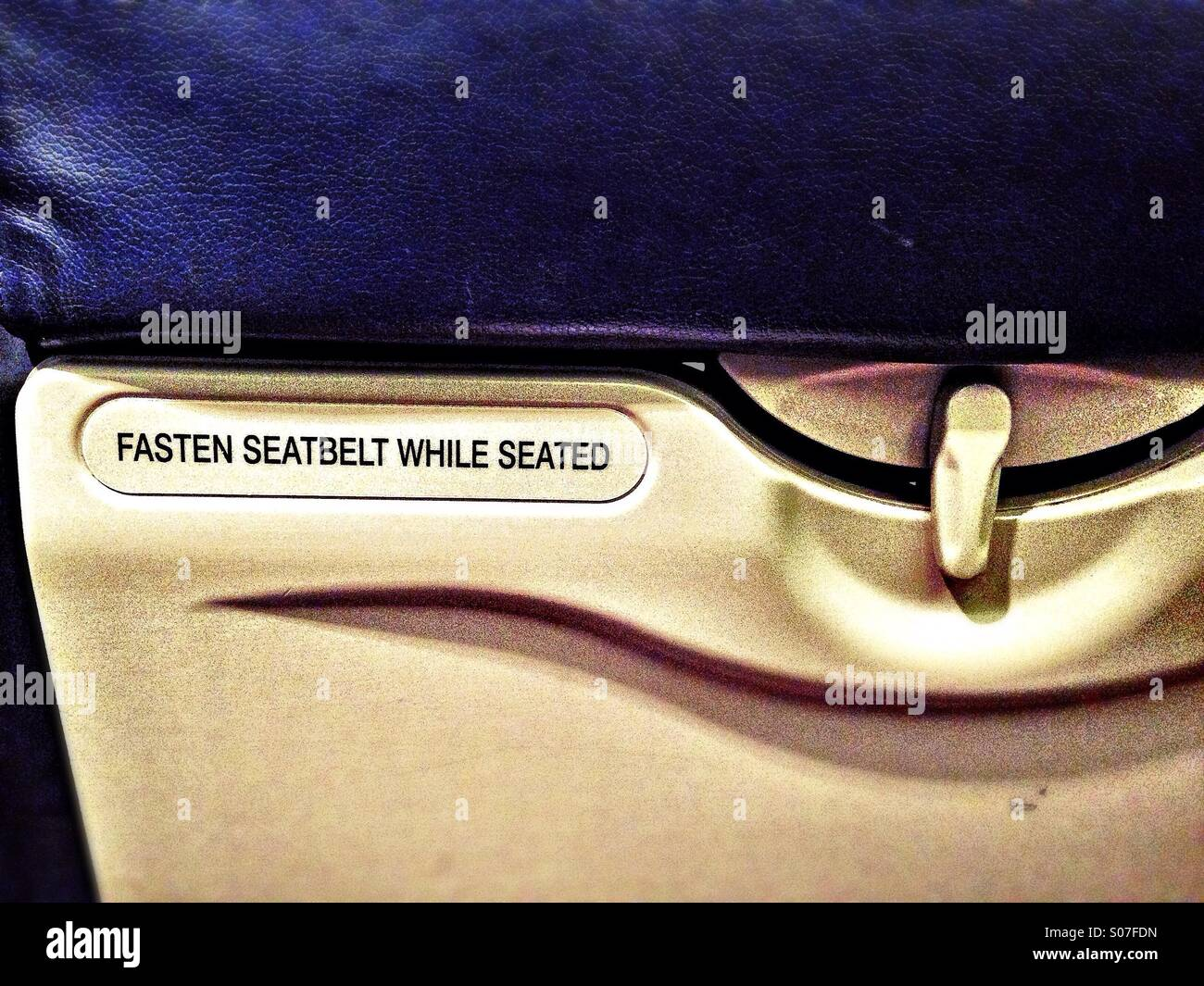 Detail in front of an airplane's seat - Stock Image