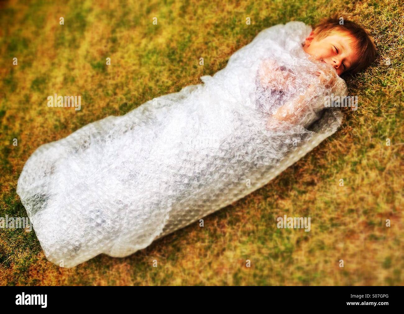 Bubble wrap boy - Stock Image