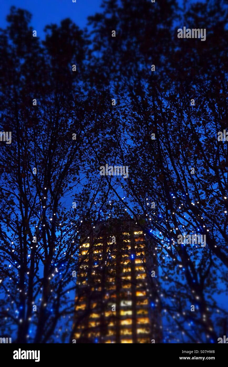 Building at night with trees and lights (tilted focus) - Stock Image