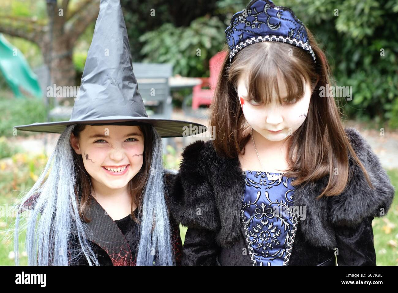 Two spooky little girls acting the part for Halloween Stock Photo